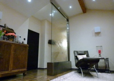 Glass waterwall in private residence