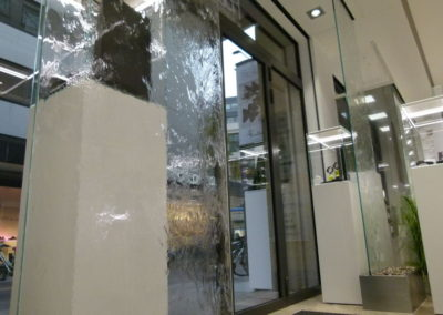 Glass waterwalls at entrance of jewelry store